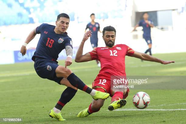 Thailand's defender Tristan Do fights for the ball against Bahrain's defender Ahmed Juma during the 2019 AFC Asian Cup group A football match between...