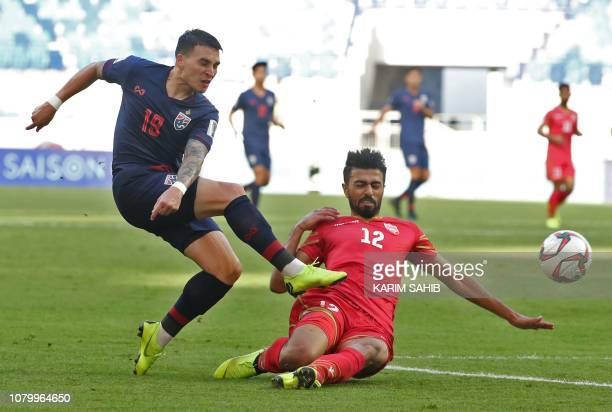 Thailand's defender Tristan Do vies for the ball against Bahrain's defender Ahmed Juma during the 2019 AFC Asian Cup group A football match between...