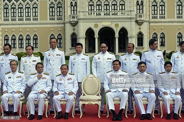 Thailand's deputy prime ministers General Prawit Wongsuwan and General Tanasak Patimapragorn along with cabinet members wait for junta chief and...