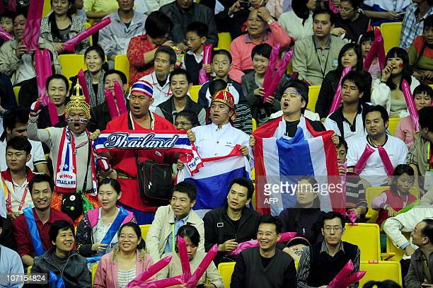 Thailand's fans cheer Tassamalee Thongjan of Thailand during the women's 5760kg boxing final competition against Dong Cheng of China at the 16th...