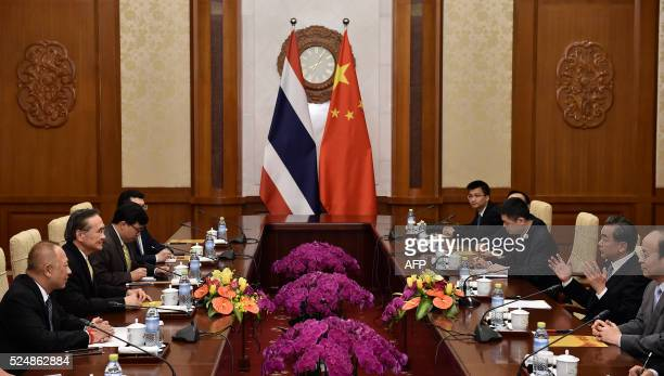 Thailand's Foreign Minister Don Pramudwinai talks with Chinese Foreign Minister Wang Yi during a meeting at the Diaoyutai State Guesthouse in Beijing...