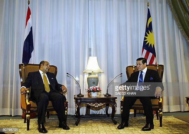 Thailand's Foreign Minister Surakiart Sathirathai confers with his Malaysian counterpart Syed Hamid Albar prior to their talks at the foreign...