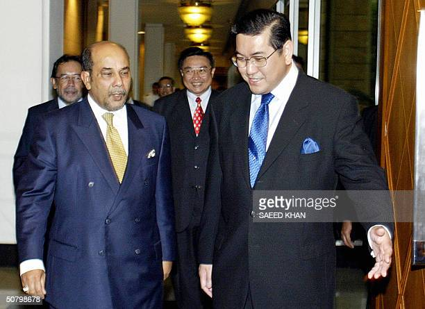 Thailand's Foreign Minister Surakiart Sathirathai escorts his Malaysian counterpart Syed Hamid Albar for talks at the foreign ministry in Bangkok 04...