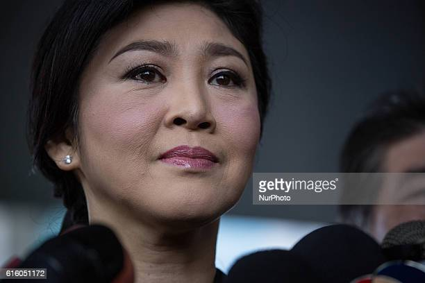 Thailand's former Prime Minister Yingluck Shinawatra speaks to media upon her arrival at the Supreme Court in Chaeng Wattana Government Complex where...