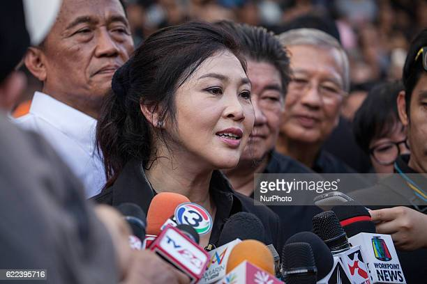 Thailand's Former Prime Minister Yingluck Shinawatra speaks to media after sold rice directly from the farmers outside Emperial Samrong Shopping Mall...