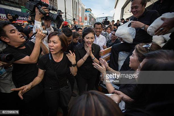 Thailand's Former Prime Minister Yingluck Shinawatra thanks her supporters to purchased rice directly from the farmers outside Emperial Samrong...