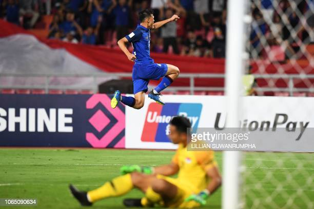 Thailand's forward Supachai Jaided celebrates after scoring during the AFF Suzuki Cup 2018 football match between Thailand and Singapore at the...