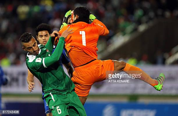 Thailand's goalkeeper Kawin Thamsatchanan holds onto the ball ahead of Iraq's Ali Adnan during their 2018 World Cup qualifying football match at...