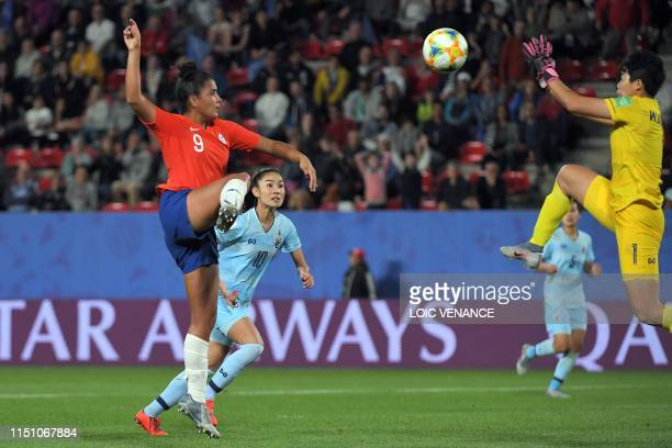 Thailand's goalkeeper Waraporn Boonsing jumps for a save on her way to make a foul during the France 2019 Women's World Cup Group F football match...