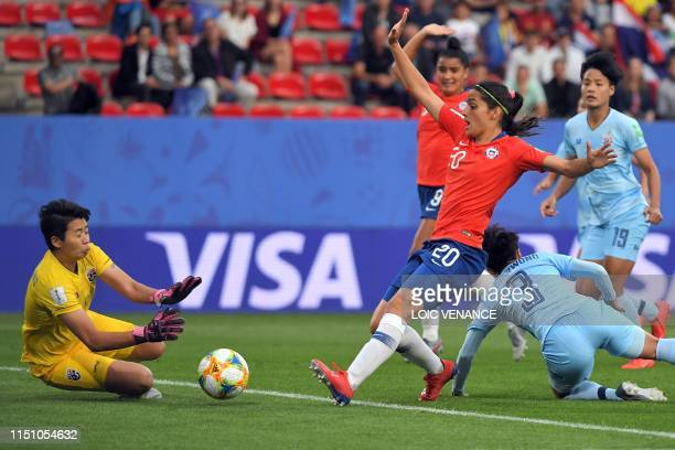Thailand's goalkeeper Waraporn Boonsing makes a save in front of Chile's forward Daniela Zamora during the France 2019 Women's World Cup Group F...