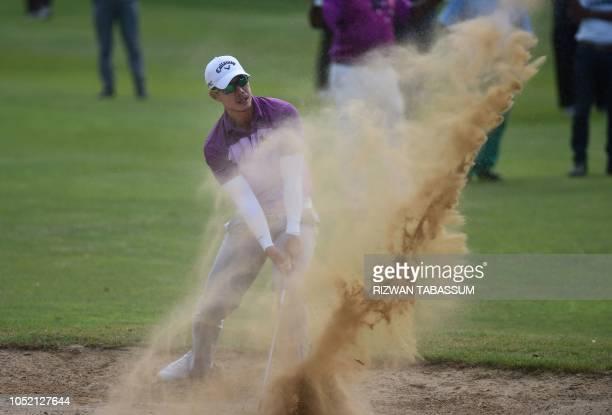 TOPSHOT Thailand's golfer Jakraphan Premsirigorn plays a shot during the UMA CNS Open Golf Championship in Karachi on October 14 2018