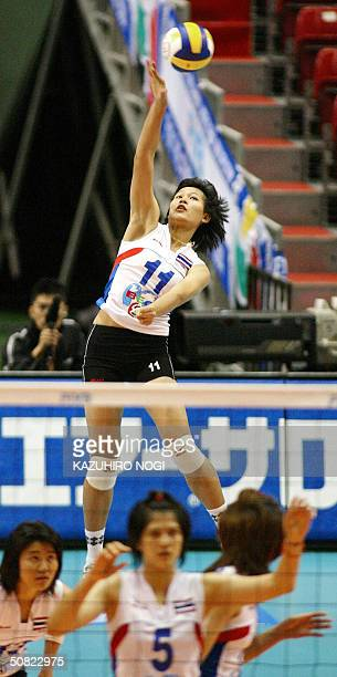 Thailand's Hyapha Amporn takes a jumping serve against Taiwan in the women's volleyball Asianfinal qualifying tournament for the Olympics in Tokyo 11...