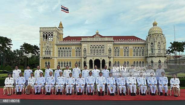 Thailand's junta chief and prime minister Prayut ChanOCha sits with members of his cabinet as they pose for a group picture following a reshuffle on...