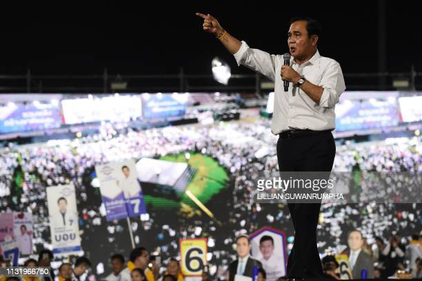 Thailand's junta leader and Phalang Pracharat party's candidate for prime minister Prayut ChanOCha gestures during the party's final major campaign...