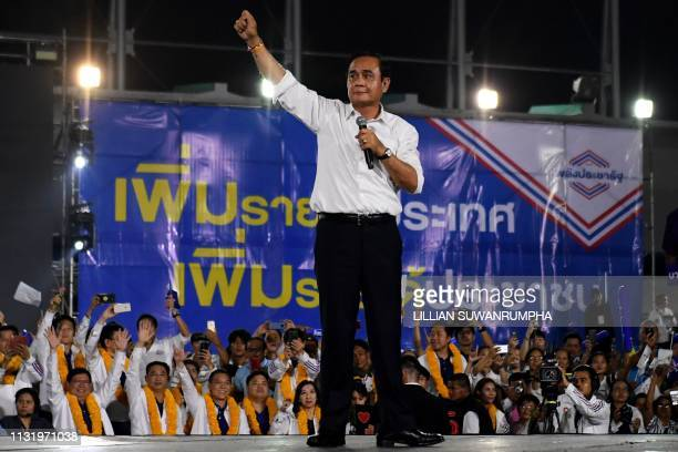 Thailand's junta leader and Phalang Pracharat party's candidate for prime minister Prayut ChanOCha speaks during the party's final major campaign...