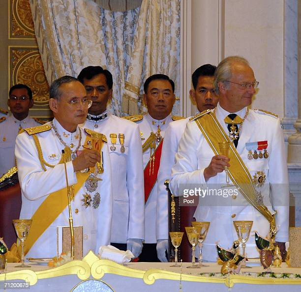 Thailand's King Bhumibol Adulyadej and King Carl Gustav of Sweden make a toast during the Royal banquet at the Golden Palace on June 13, 2006 in...