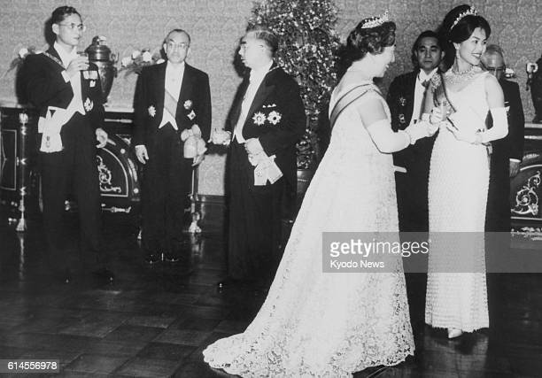 Thailand's King Bhumibol Adulyadej and Queen Sirikit attend a welcome ceremony held by Japanese Emperor Hirohito and Empress Nagako at the Imperial...