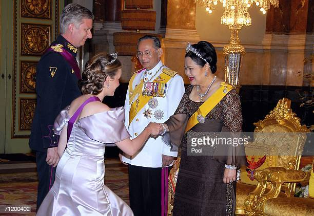 Thailand's King Bhumibol Adulyadej and Queen Sirikit greet Crown Prince Philippe of Belgium and Princess Mathilde of Belgium as they attend the Royal...