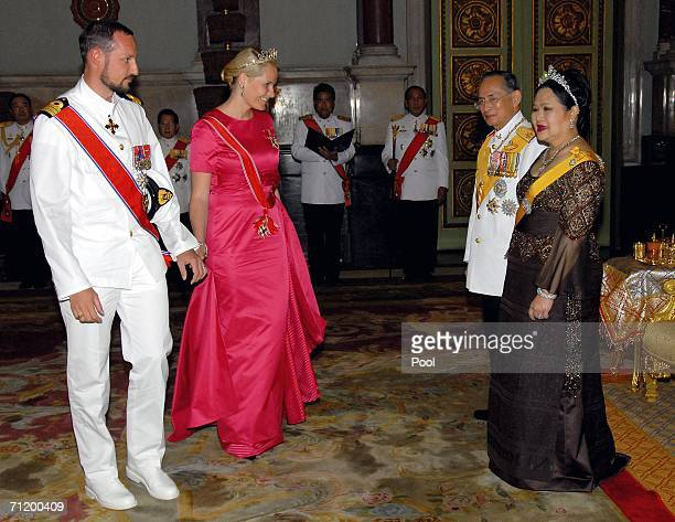 Thailand's King Bhumibol Adulyadej and Queen Sirikit greet Crown Prince Haakon of Norway and Princess Mette-Marit of Norway as they attend the Royal...