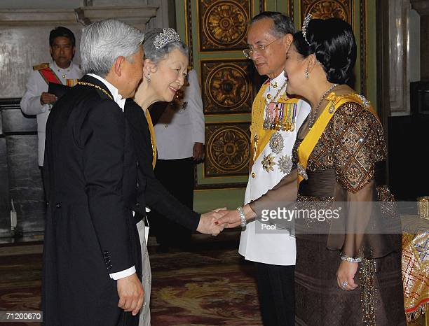 Thailand's King Bhumibol Adulyadej and Queen Sirikit greet Emperor Akihito of Japan and Empress Michiko of Japan as they arrive to attend the Royal...