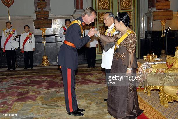 Thailand's King Bhumibol Adulyadej and Queen Sirikit greet Grand Duke Henri of Luxembourg as they attend the Royal banquet at the Golden Palace on...