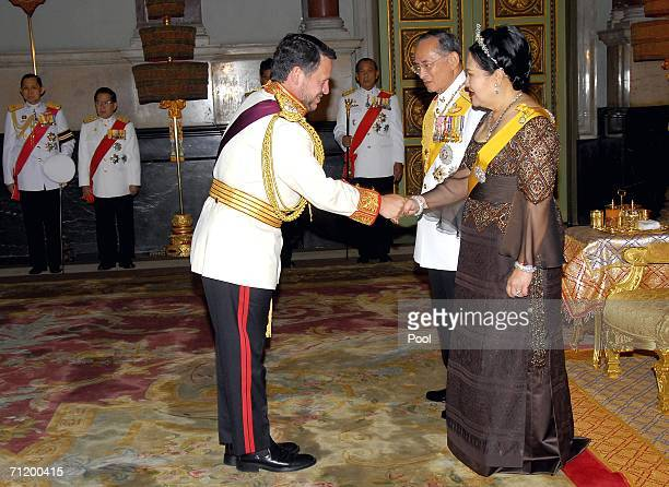 Thailand's King Bhumibol Adulyadej and Queen Sirikit greet King Abdullah II Bin Al-Hussein of Jordan as they attend the Royal banquet at the Golden...