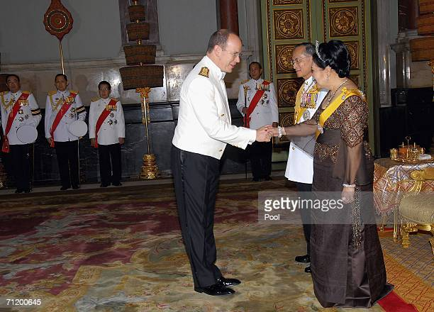 Thailand's King Bhumibol Adulyadej and Queen Sirikit greet Prince Albert II of Monaco as they attend the Royal banquet at the Golden Palace on June...