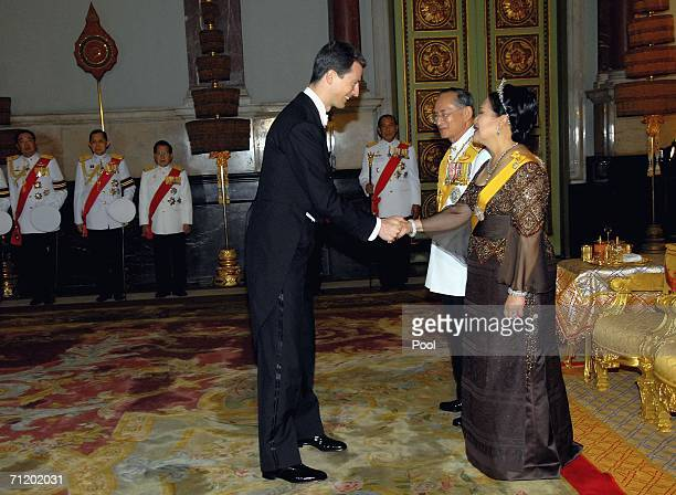Thailand's King Bhumibol Adulyadej and Queen Sirikit greet Prince Alois of Leichtenstein as they attend the Royal banquet at the Golden Palace on...