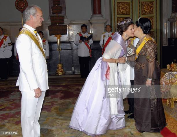 Thailand's King Bhumibol Adulyadej and Queen Sirikit greet Queen Silvia of Sweden and King Carl Gustav of Sweden as they attend the Royal banquet at...