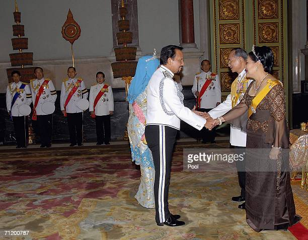 Thailand's King Bhumibol Adulyadej and Queen Sirikit greet the Sultan of Brunei as they attend the Royal banquet at the Golden Palace on June 13,...