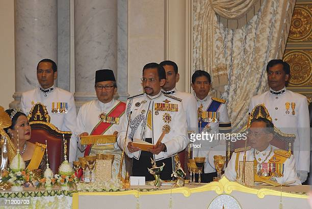 Thailand's King Bhumibol Adulyadej and Sultan of Brunei look on during the Royal banquet at the Golden Palace on June 13, 2006 in Bangkok, Thailand....