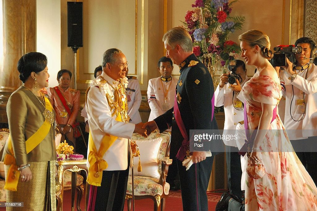 Thailand's King Bhumibol Adulyadej (R) greets Crown Prince Philippe of Belgium and Princess Mathilde at Ananda Samakhom Throne Hall on June 12, 2006 in Bangkok, Thailand. The representatives of 25 royal houses from Europe, Africa, the Middle East and Thailand's Asian neighbors trooped into the elaborate century-old hall to convey their best wishes on the 60th anniversary of the 78-year-old king's accession to the throne.