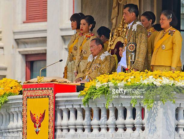 Thailand's King Bhumibol Adulyadej is surrounded by his Daugthers Princess Ubol Ratana Chulabhorn His son Crown Prince Vajiralongkorn and Princess...