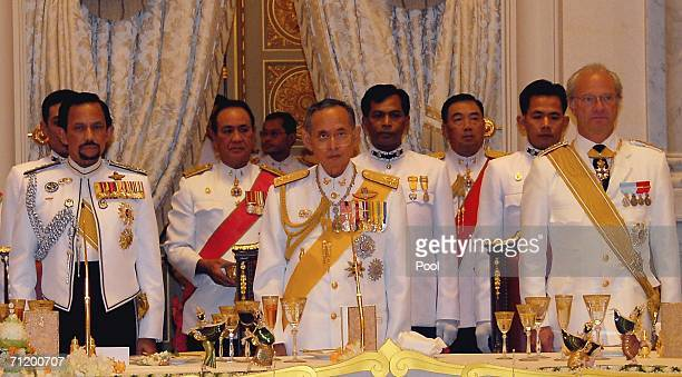 Thailand's King Bhumibol Adulyadej King Carl Gustav of Sweden and Sultan of Brunei stand during the Royal banquet at the Golden Palace on June 13,...