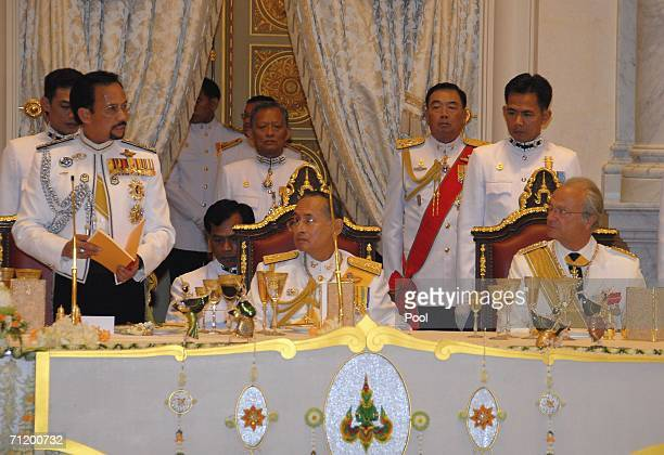Thailand's King Bhumibol Adulyadej , King Carl Gustav of Sweden and the Sultan of Brunei look on during the Royal banquet at the Golden Palace on...