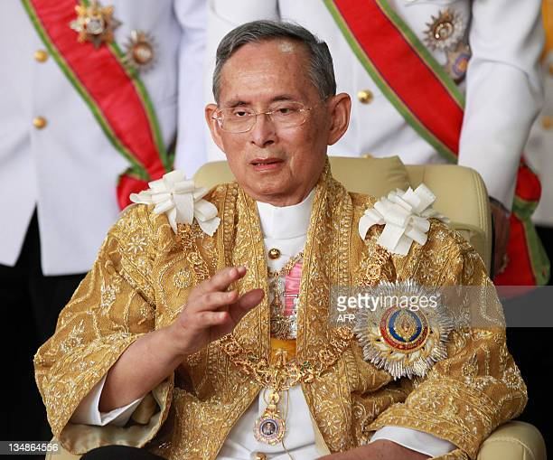 Thailand's King Bhumibol Adulyadej waves as he returns from the Grand Palace to Siriraj Hospital in Bangkok on December 5, 2011 on his 84th birthday....