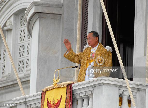 Thailand's King Bhumibol Adulyadej waves to thousands of people waiting outside the Royal Plaza June 9 2006 in Bangkok Thailand Thailand begins a...