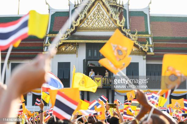 Thailand's King Maha Vajiralongkorn and Queen Suthida appear on the balcony of Suddhaisavarya Prasad Hall of the Grand Palace while people wave...