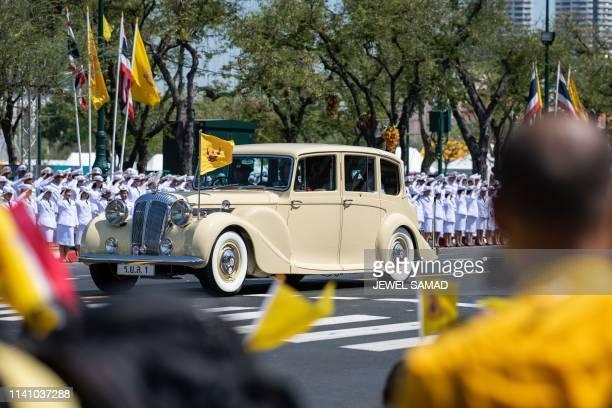 Thailand's King Maha Vajiralongkorn and Queen Suthida arrive at the Grand Palace for his coronation in Bangkok on May 4 2019