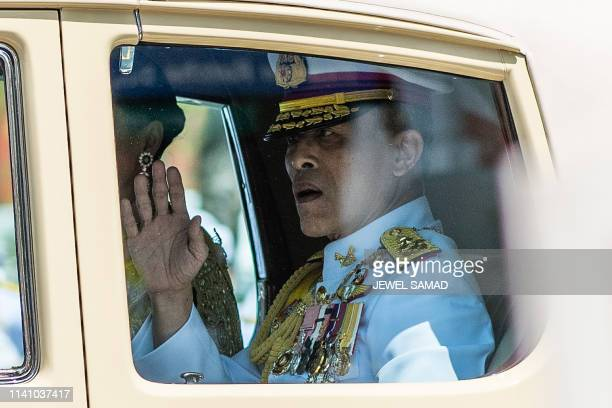 Thailand's King Maha Vajiralongkorn and Queen Suthida arrive at the Grand Palace for his coronation in Bangkok on May 4 2019