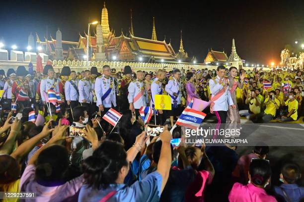 TOPSHOT Thailand's King Maha Vajiralongkorn and Queen Suthida greet royalist supporters outside the Grand Palace after a Buddhist ceremony for the...