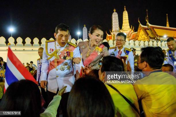 Thailand's King Maha Vajiralongkorn and Queen Suthida greet royalist supporters after a Buddhist ceremony for the late king Chulalongkorn in Bangkok...