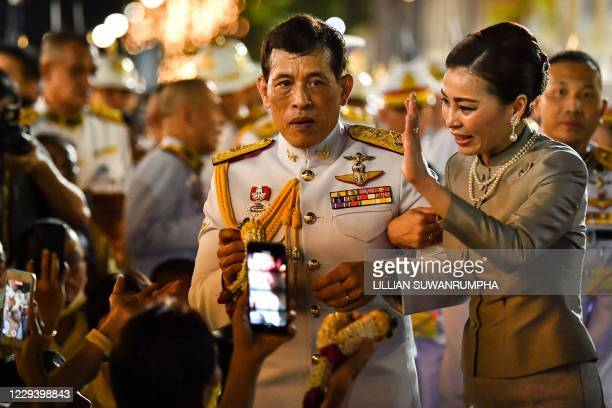 TOPSHOT Thailand's King Maha Vajiralongkorn and Queen Suthida greet royalist supporters outside the Grand Palace in Bangkok on November 1 2020 after...