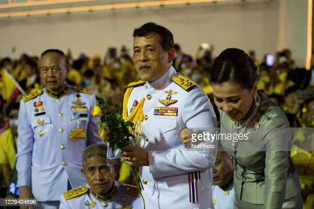 Thailands King Maha Vajiralongkorn and Queen Suthida greet royalist supporters outside the Grand Palace in Bangkok on November 1, 2020 in Bangkok,...