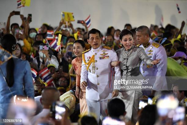 Thailand's King Maha Vajiralongkorn and Queen Suthida greet supporters outside the Grand Palace in Bangkok on November 1 2020 after presiding over a...