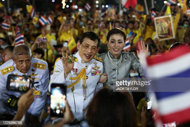 Thailand's King Maha Vajiralongkorn and Queen Suthida greets supporters outside the Grand Palace in Bangkok on November 1 2020 after presiding over a...