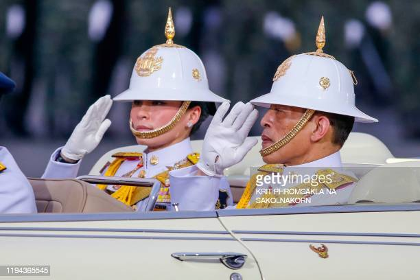 Thailand's King Maha Vajiralongkorn and Queen Suthida salute while inspecting military troops during parade ceremony marking the Royal Thai Armed...