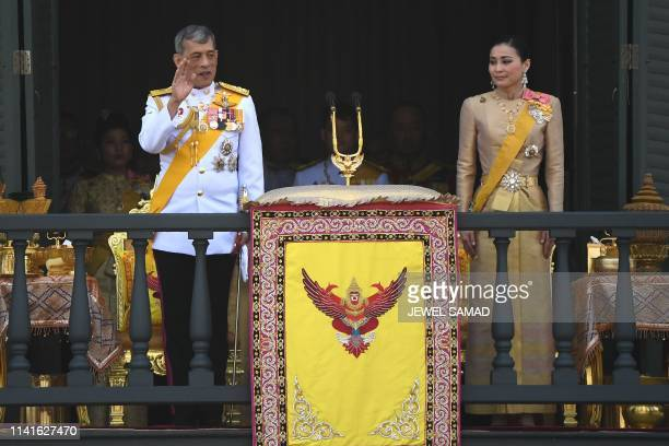 Thailand's King Maha Vajiralongkorn and Queen Suthida wave to wellwishers from the balcony of Suddhaisavarya Prasad Hall of the Grand Palace as they...