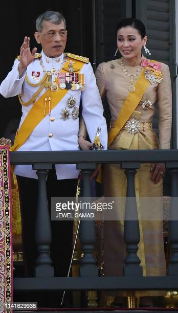 Thailand's King Maha Vajiralongkorn and Queen Suthida wave to well-wishers from the balcony of Suddhaisavarya Prasad Hall of the Grand Palace as they...