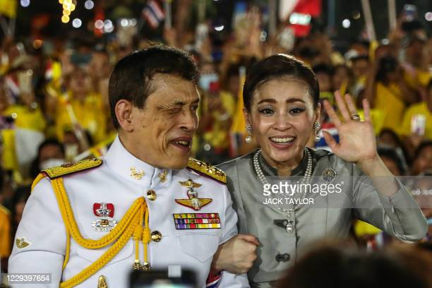 Thailand's King Maha Vajiralongkorn and Queen Suthida wave to supporters outside the Grand Palace in Bangkok on November 1 2020 after presiding over...